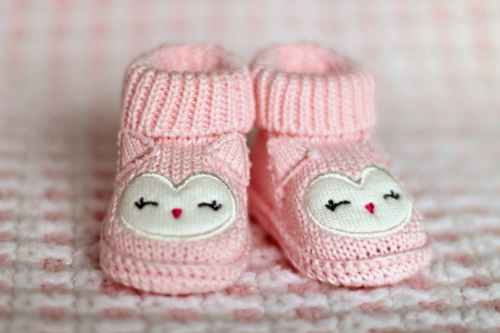 close up of pink baby booties