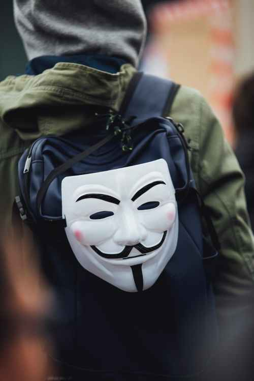 photo of guy fawkes mask on backpack